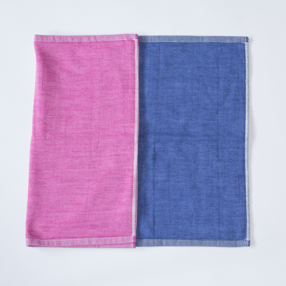 The Yoshii two-tone chambray towel in Blue 2 and Pink 2.