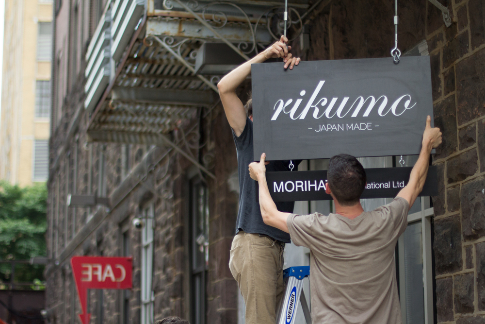 Chris and Tom from the Rikumo marketing team help install our new sign.