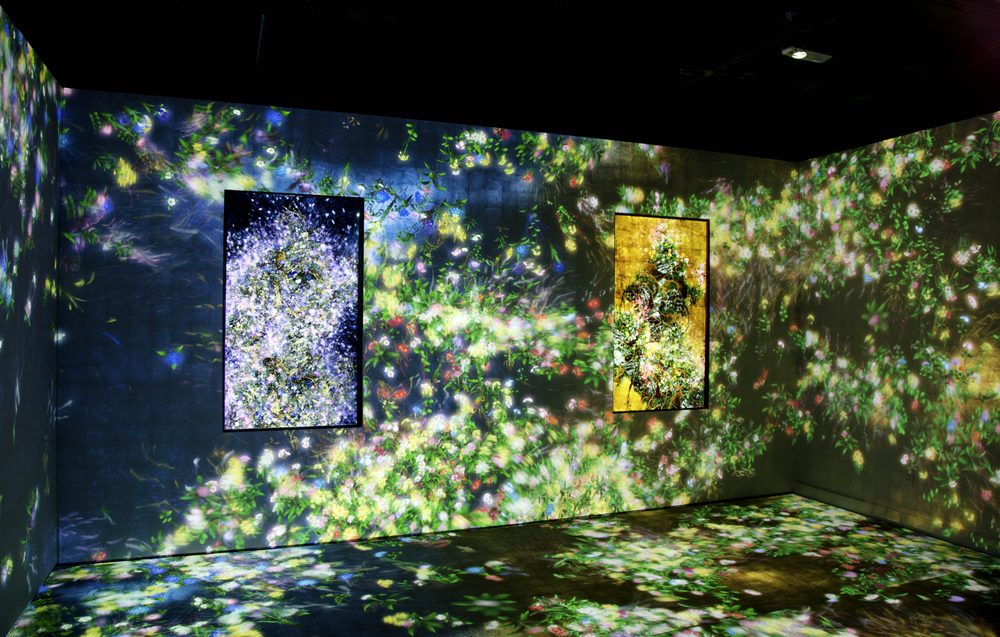 teamLab (est. 2001), Flowers and People—Gold and Dark, 2014. Digital work. Endless. Courtesy of the artist and Pace Gallery. Surrounding (from left to right) Ever Blossoming Life—Dark, 2014, and Ever Blossoming Life—Gold, 2014, both digital works, endless, courtesy of the artist and Pace Gallery. Installation photo by Richard P. Goodbody.