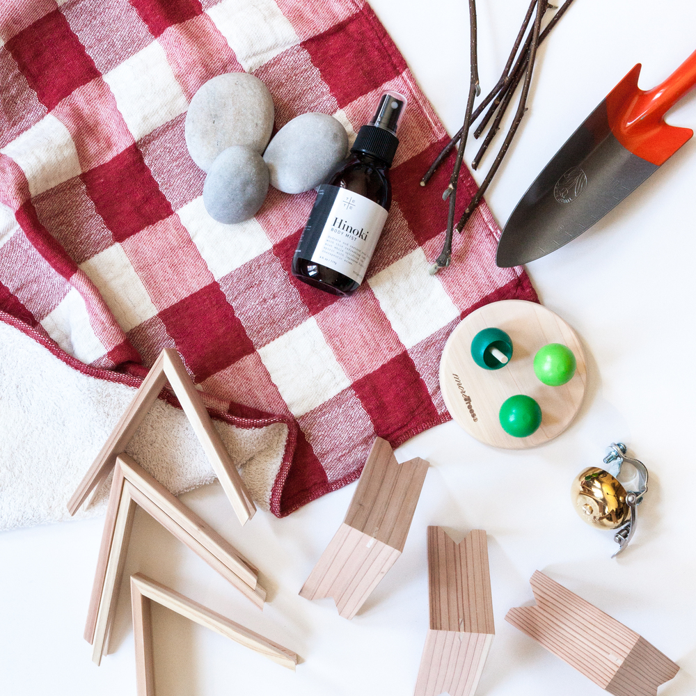 Pictured clockwise from right:  Tulip Trowel ,   Wooden Tree Tops ,  Bicycle Bell , Wooden Building Blocks (store exclusive),  Vintage Check Towel ,  Hinoki Body Mist .