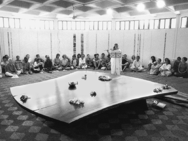 Mira Nakashima, playing the flute at the unveiling of the third Altar for Peace in Auroville, India.