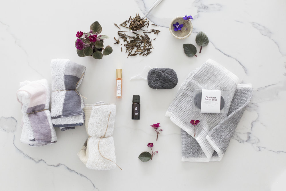 Clockwise from center right:  Binchotan Charcoal Facial Puff,   Binchotan Charcoal Body Scrub Towel,   Binchotan Charcoal Facial Soap ,  Japan Botanicals Yoshino Hinoki Essential Oil ,  Palette Towel ,  Herbivore Phoenix Facial Oil  (shop it at Terrain).
