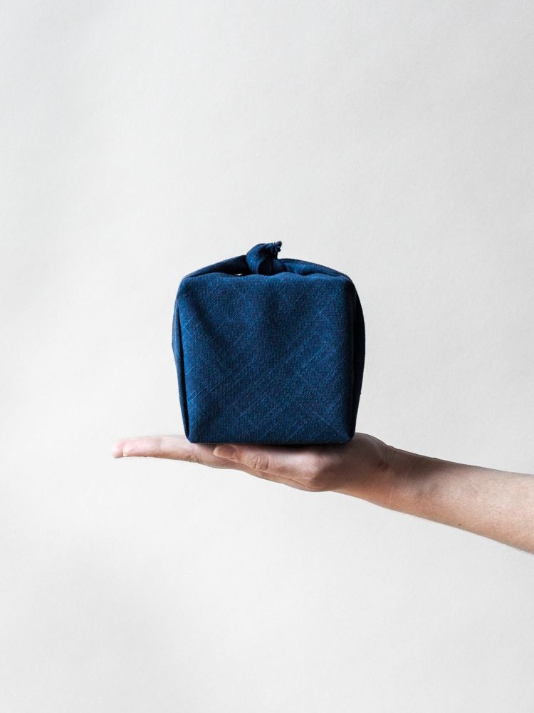 Furoshiki  is a traditional type of reusable wrapping cloth that can be fashioned into a bag or used to wrap gifts. We carry several styles, and you can find a few wrapping ideas  here .
