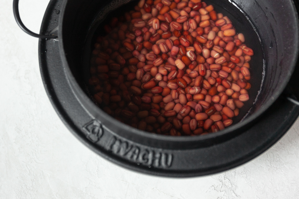Lightly submerge the beans so they don't roll when they boil.