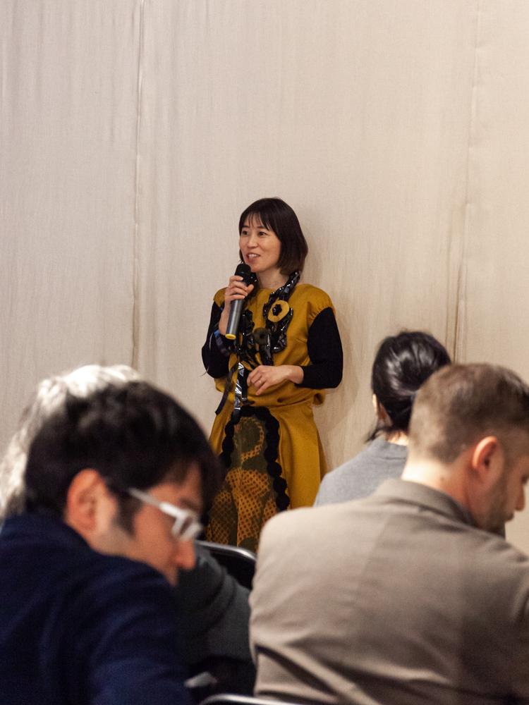 CCJ Director Ann Adachi-Tasch providing translations.