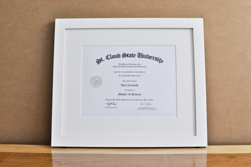 "Style: Medium Frame Color: White Mat: 2"" Off-White Diploma: 11"" W x 8 1/2"" H"