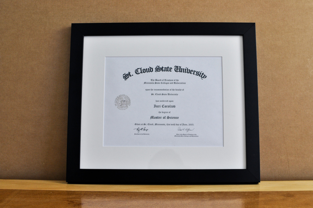 "Style: Medium Frame Color: Black Mat: 2"" Off-White Diploma: 11"" W x 8 1/2"" H"