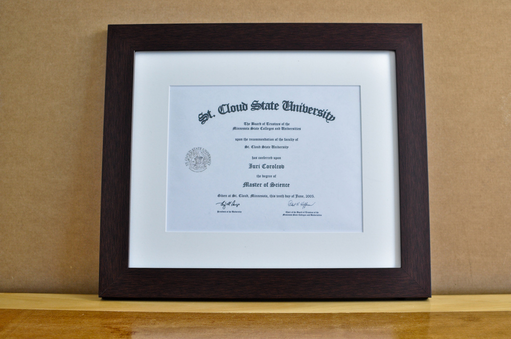 "Style: Medium Frame Color: Walnut Mat: 2"" Off-White Diploma: 11"" W x 8 1/2"" H"