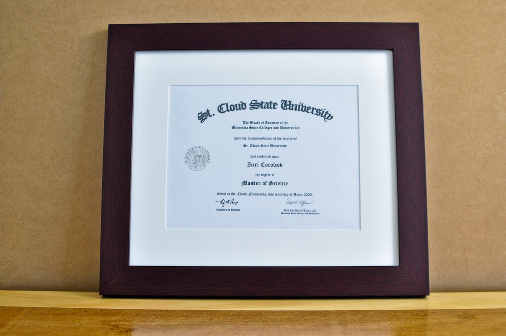"Style: Medium Frame Color: Mahogany Mat: 2"" Off-White Diploma: 11"" W x 8 1/2"" H"