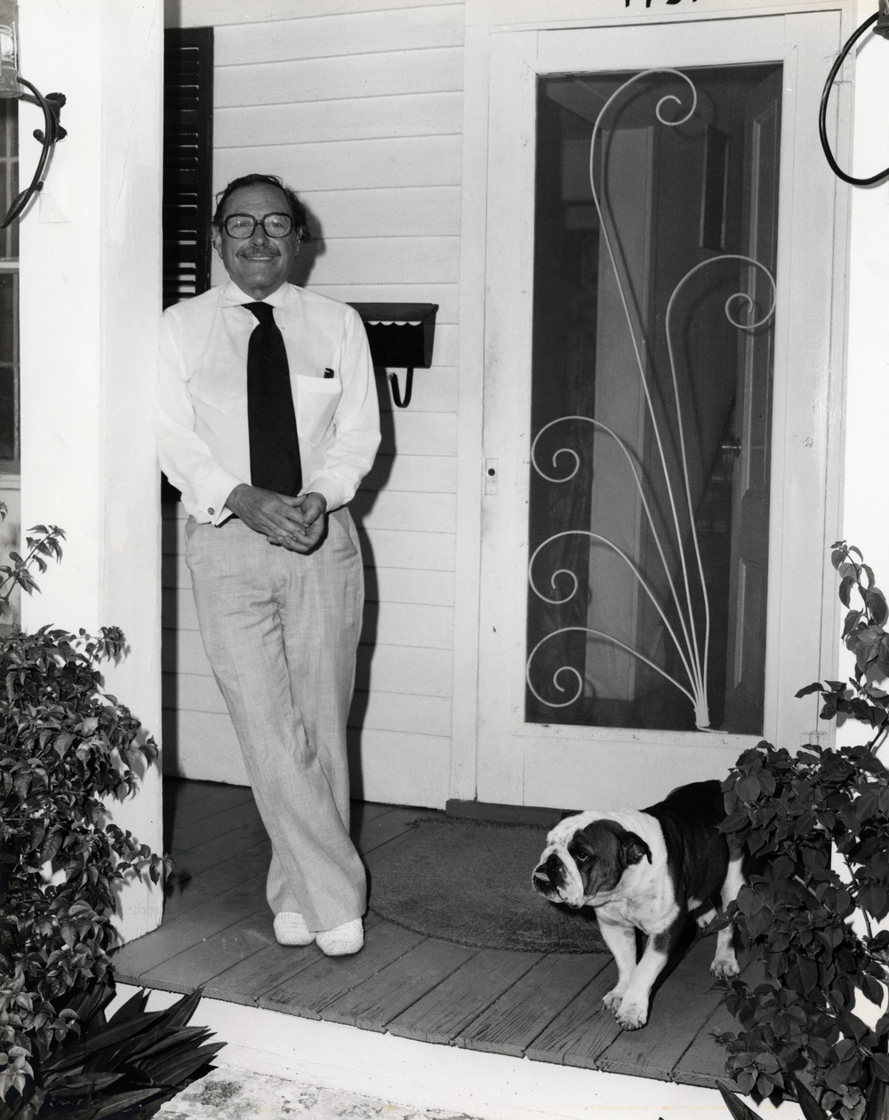 Tennessee Williams on his porch on Duncan Street. He bought the house in 1949 and owned it till his death in 1983. Photo from the Monroe County Library collection.