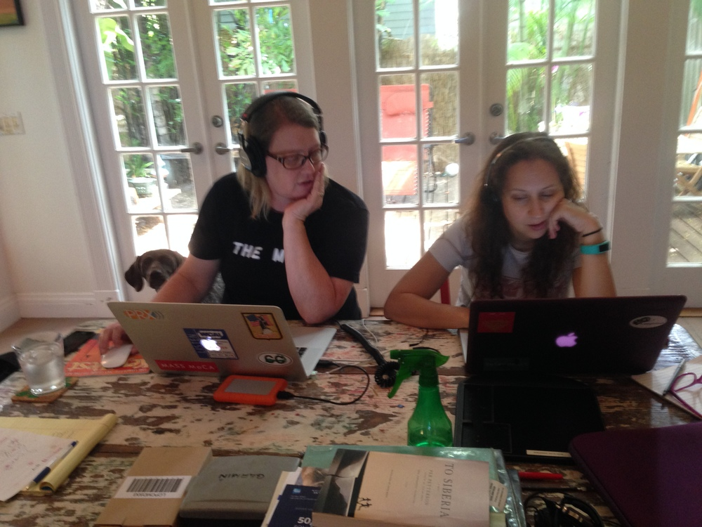 Making radio with Alicia Zuckerman, WLRN editorial director, in the Southernmost Bureau. Photobomb by Elly. Photo by Mark Hedden.
