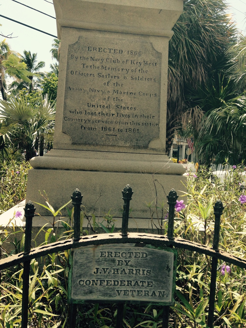 Key West's complicated Civil War legacy is on display at Clinton Place, near Key West Harbor. The obelisk built by the Navy Club for Union forces who died here during the war is surrounded by a cast-iron fence built by a Confederate veteran. Photo by Nancy Klingener.