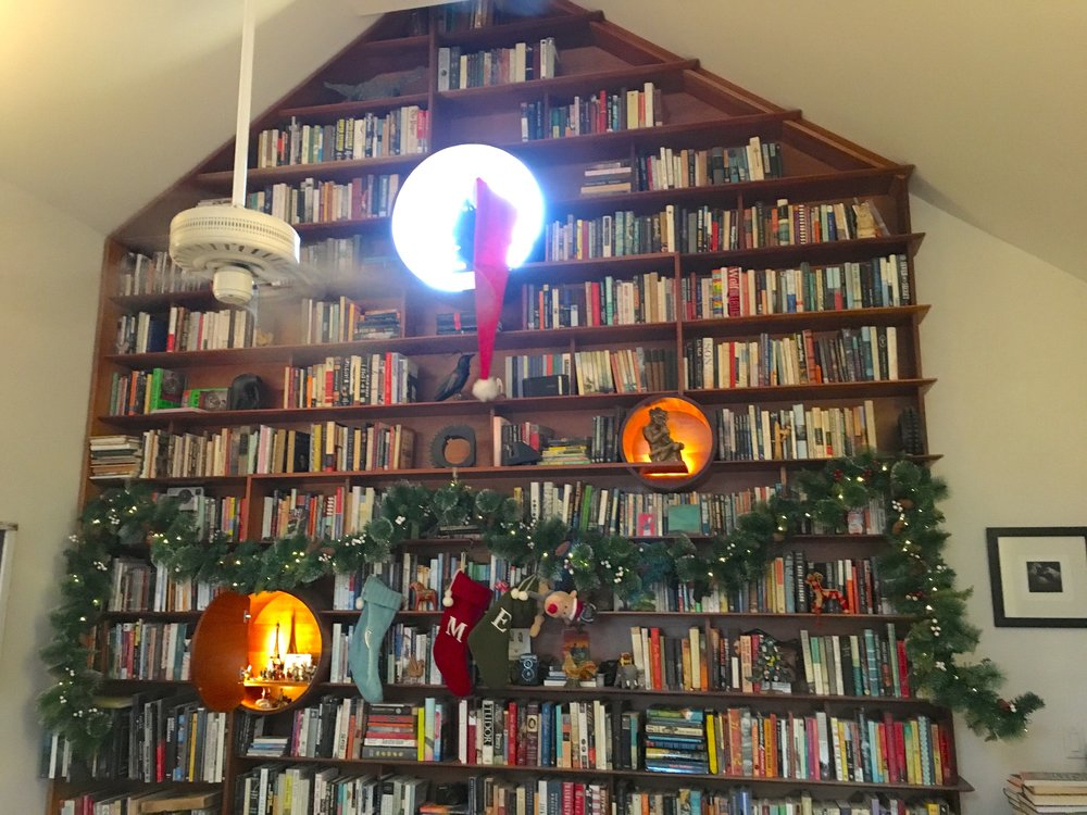 I love our bookshelf all year round, but I especially love decorating it for the holidays.