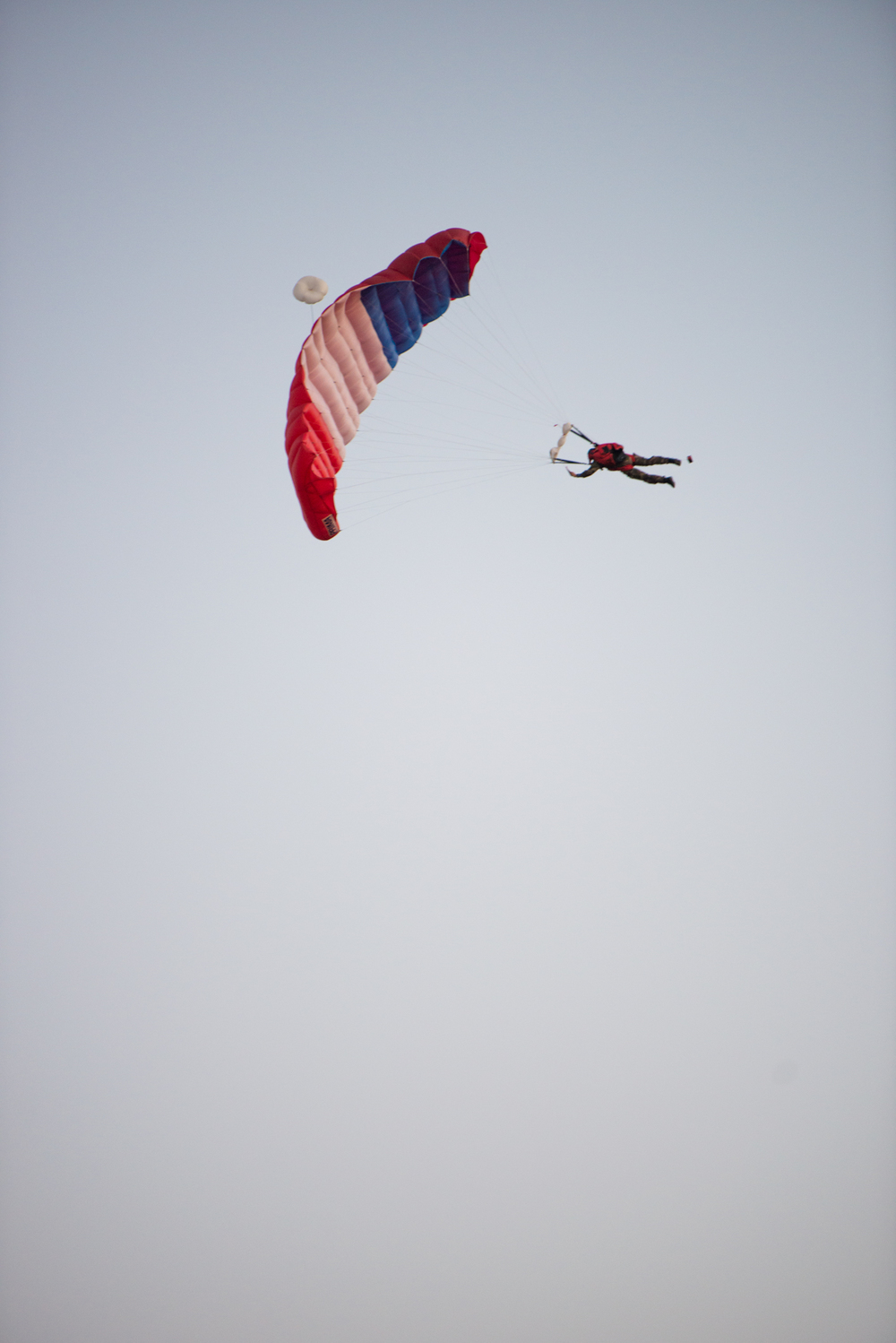 To celebrate Bastille Day, paratroopers jumped from planes and landed to the surprise of visitors.