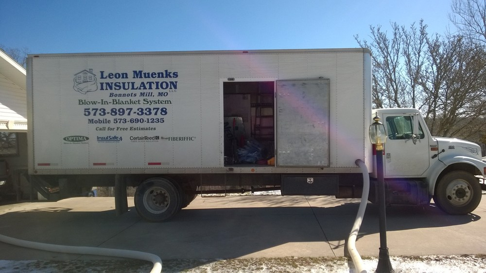 Truck and hose for attic insulation in Jefferson City, MO