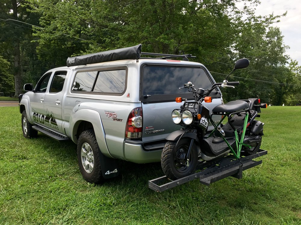 Adventure based scooting, you say? 114mpg you say?! No foreign country in the name, you say?!?  Enter the 2015 Honda Ruckus owned and operated by Bold Overland. This little scoot packs a massive amount of adventure in a tiny little fun-sized package. No. Seriously. It does.  We use this thing around shows, events, training weekends, and to just explore. It sits snugly on the back of the Bold Tacoma and acts as an escape pod, of sorts. It's lack of manual transmission, power, or tall seat height makes it easy for anyone to hop on and do some exploring. We love to toss the equally tiny key to anyone at our events that wants to take it for a spin. They always come back with a huge smile on their face.  And, ultimately, that's what it's all about. Having fun exploring new things and new places. The Bold Ruckus lets anyone go explore.  Anyone. Kevan Ray • 2015 Honda Ruckus