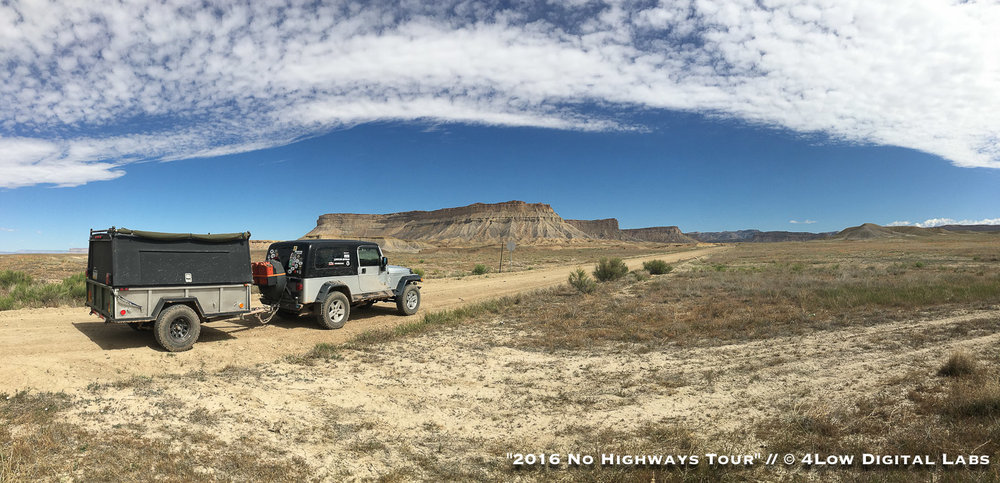 "This photo is from my 2016 ""No Highways Tour"" trip earlier this year. It's at the entry to the Book Cliffs in Utah just east of Green River. The premise of the whole trip was to avoid major highways and explore the best backcountry in the area. Jeep is a 2004 Wrangler Unlimited with a 2"" suspension lift and 32"" mud-terrains with 4.88 gears and a front locker. The trailer is a military surplus M101 with a truck cap converted into a sleeper. Both the Jeep and the trailer were built with budget-minded travel in mine. The trailer itself was built for under $1,200. The Jeep is built to be rugged, yet not over the top. Dean Shirley • 2004 Jeep Wrangler Unlimited"