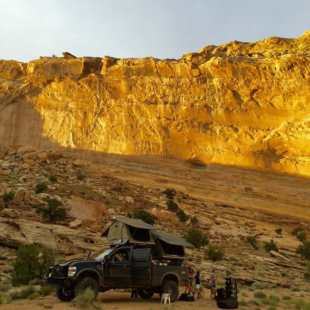 Picture taken in Green River, Utah on the Trans America Trail, which our family completed July 2015.  We are the Stringer Family. Doug, Louisa, Kora, Jilly, Sephine and our dog, Trip. You can add Lumpy in there too. He is definitely a part of us. Overland travel has become a universal enjoyable adventure experience for our family. We have completed 3/4 of North America in our travels over the last 7 years. Beginning in 2008, Lumpy has been transformed from a stock Ford F350 to a stellar beast of an overland machine helping us travel tirelessly and enthusiastically throughout this land and these people on this gift we call Earth. All racks, bumpers, rock-sliders designed by Doug Stringer. Doug Stringer • 2008 Ford F350