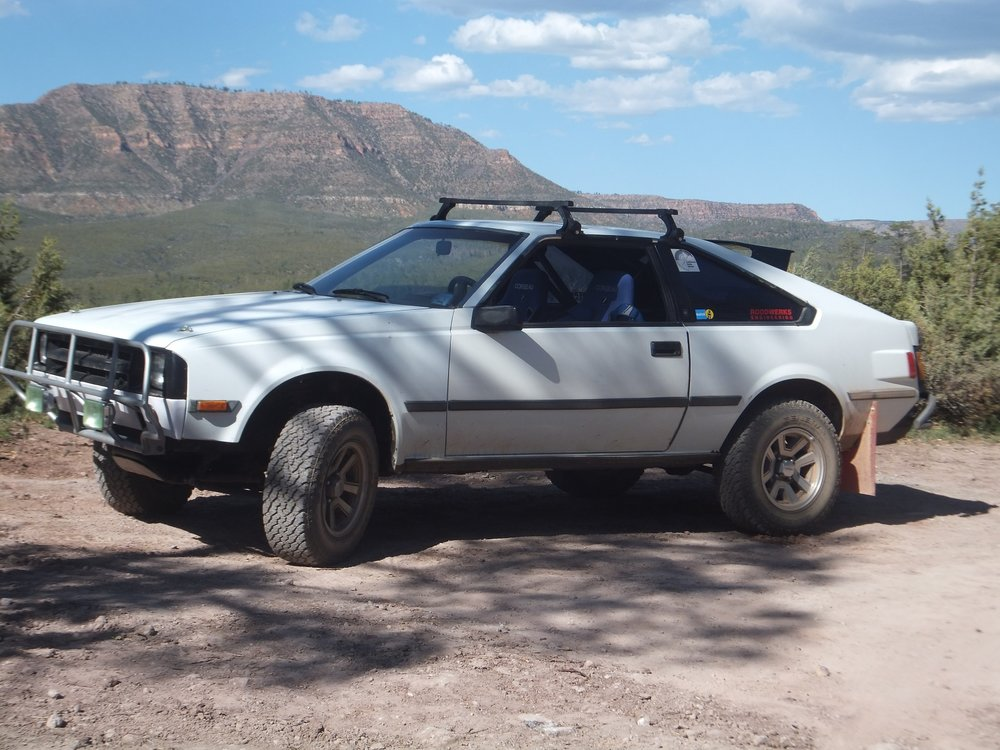 I built the unique car to traverse the typically hard packed, slightly rocky terrain of the SouthWest, specifically AZ. It's used for more day trips than longer stays out from home, but being a hatchback, will back in a lot when needed. Jon Rood • 1984 Toyota Celica •