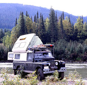 I have owned and traveled in my 56 year old Land Rover Dormobile for 38 years. The rear interior camper section of the Dormobile is 6.5 feet long and 4.5 feet wide. In that space is a pull out cot bed, cooker with 2 burners, a broiler, and storage underneath. There are 2 sinks with running water, a chest refrigerator, folding rear jump seat, porta pottie, and two tall wardrobe cabinets for storage. The truck has 3 fuel tanks with a total fuel capacity of 42 US gallons, a stainless steel 15 gallon drinking water tank, 5 gallon horizontal mount propane tank, and a horizontal mount compressed air tank filled by a 12V on-board air compressor. The second batter can be charged from the alternator of solar panels. The drive train consists of a fuel injected Ford 5.0 V8, NP435 gearbox, and Series Land Rover transfercase. The rear differential is a Dana 60 with ARB air locker, and stronger than stock axles. The front has a Trutrac limited slip and super strong 24 spline axles. With the 4.7:1 ring and pinion gears the low range first gear ratio at the axles is 50:1.The truck will go anyplace the 33.3 inch dia BFG Mud Terrains can find bight, and home is where I pop the top. 38 years of ownership and travel with many more yet to come.