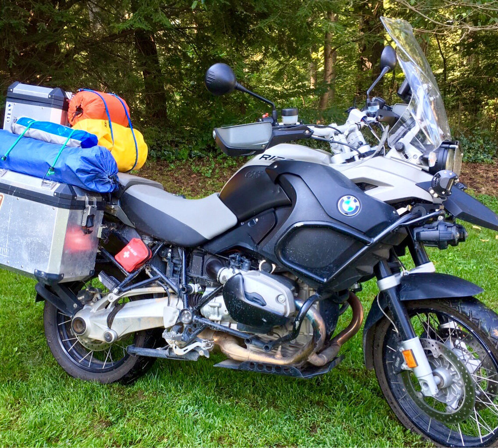 This is Hilde, a 09 R1200 GSA. She is equipped with touratech skid plates, aluminum panniers, oil cooler guard, mudsling rear fender, and 1800 lumen flood lights just to name a few. Hilde loves to eat up tarmac and splash in the mud. She has taken us for multi day adventures, day treks through the Smoky Mountains, and rides around town. It seems every time we taker her it is an adventure!