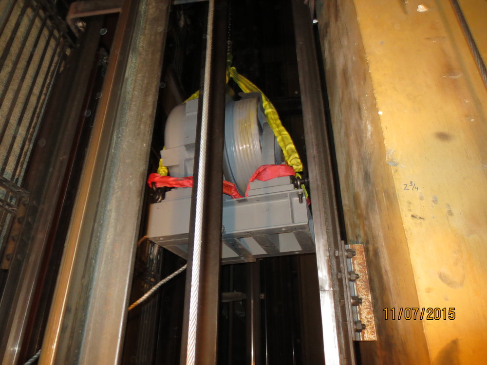 Hoisting new equipment up through elevator hoistways because of limited access.