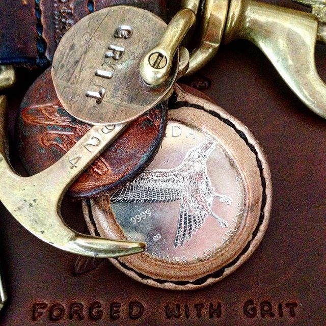 That time @ericpeverett gave me a Canadian Red-tailed hawk silver coin and I made a sheath for it to go on my key rig. #brotherhood #Canada #halfpoundkeyrig #silver #coin #leather #key #keychain #handmade #madeintexas