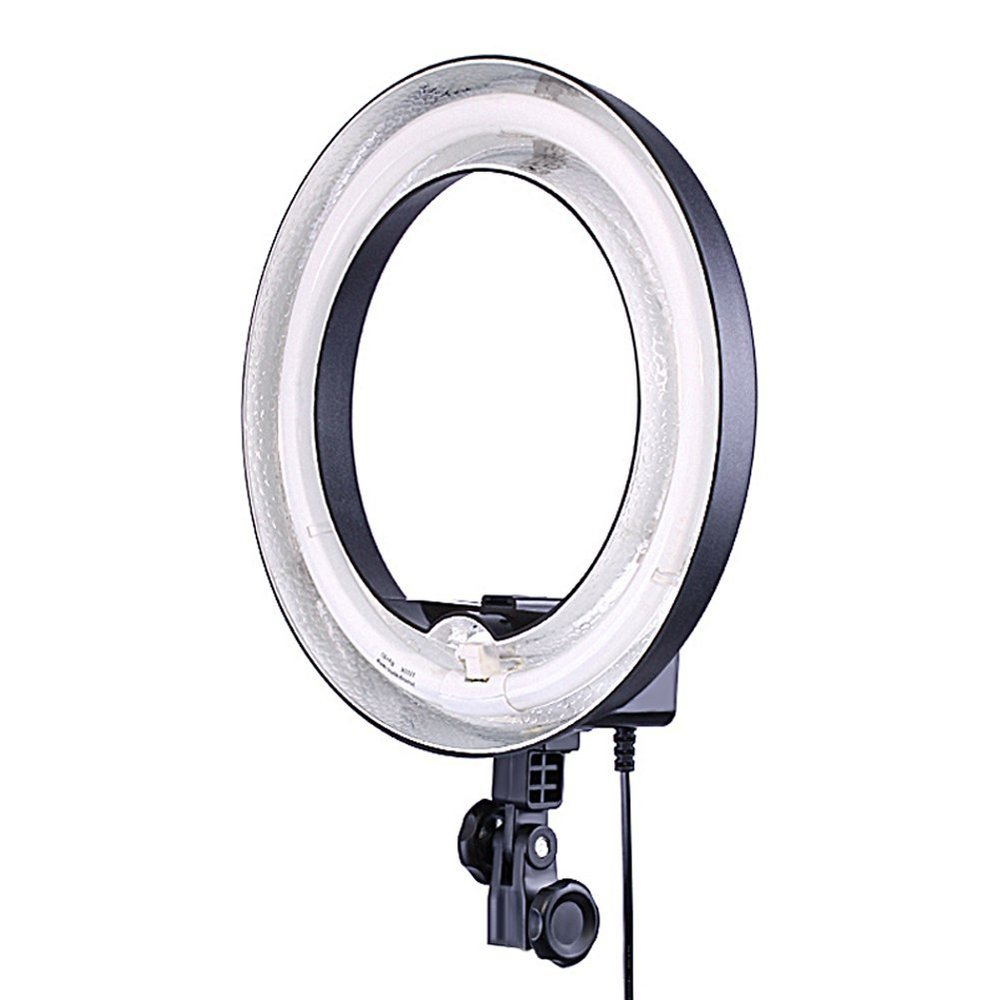 "Neewer Ring Light We use this light to get even lighting in our vides. If pointed directly at the face, this also gives that cool ""ring in the eyes"" look. If you're into that sort of thing..."