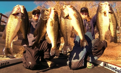 Tim and Matt with handfuls of bass that were easily landed on 20-30 lb braided line