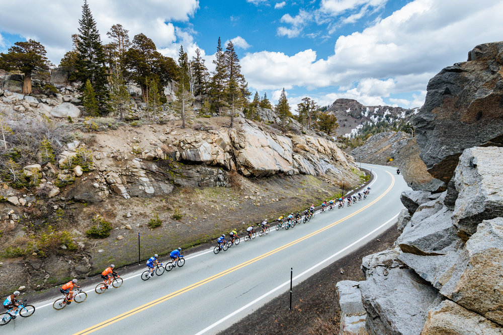 A stretched out peloton passes over Carson Pass in the central Sierra Nevada during the 2018 Amgen Tour of California.  Photo / Greg Mionske
