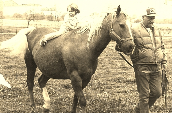 Megan ~3 years old. Riding bareback. Led by a trustworthy neighbor.
