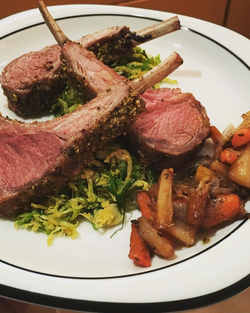 Pistachio Encrusted Lamb over Brussels Sprouts with Caramelized Carrots