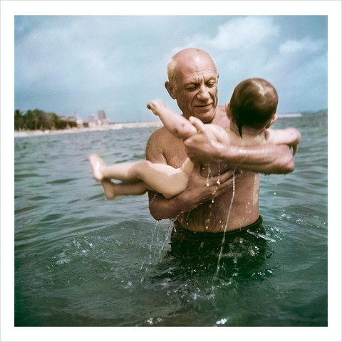 Pablo Picasso playing in the water with his son Claude. Vallauris, France. 1948.