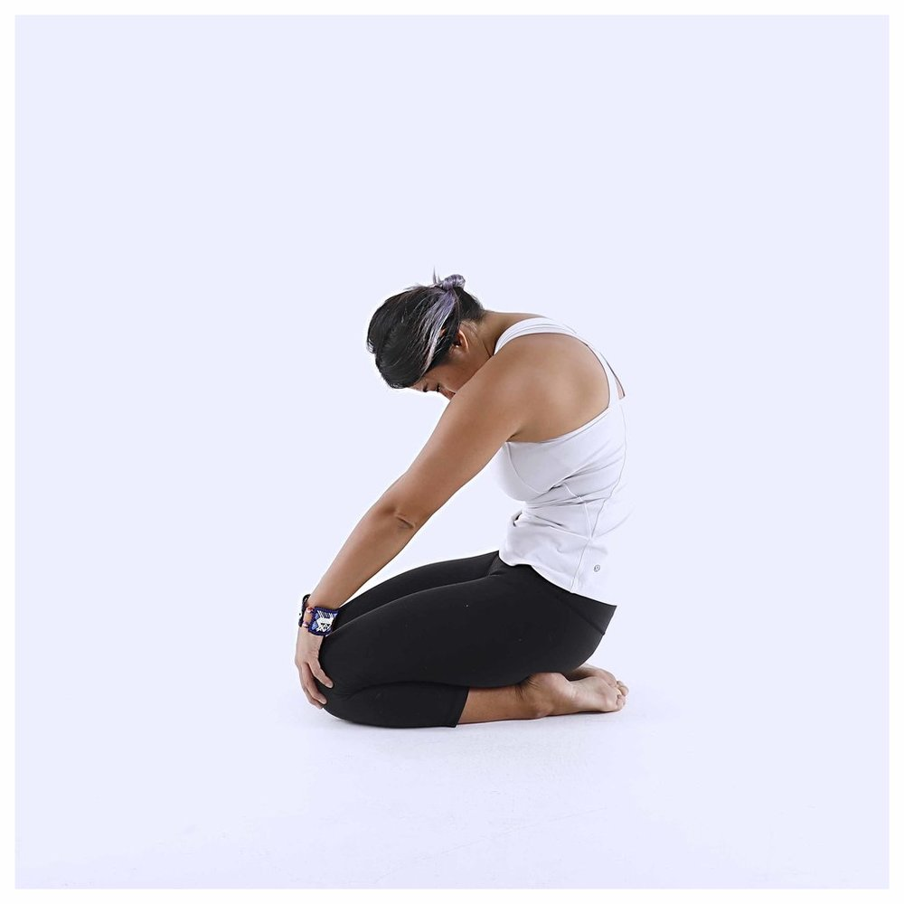 Hunching. Very helpful for upper back/neck tension. Can be done crossed legged, sitting in a chair or kneeling as pictured.