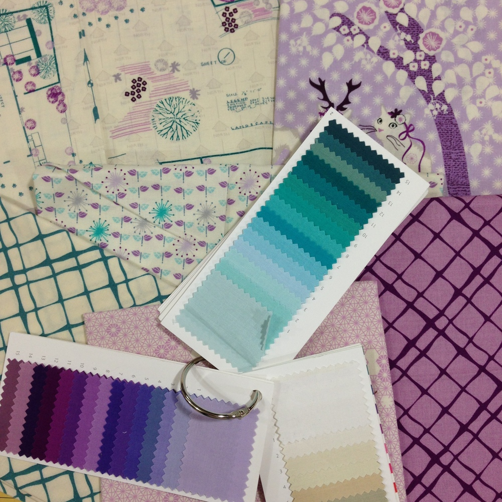 "The ""lilac"" range with Michael Miller Cotton Couture color cards for reference."