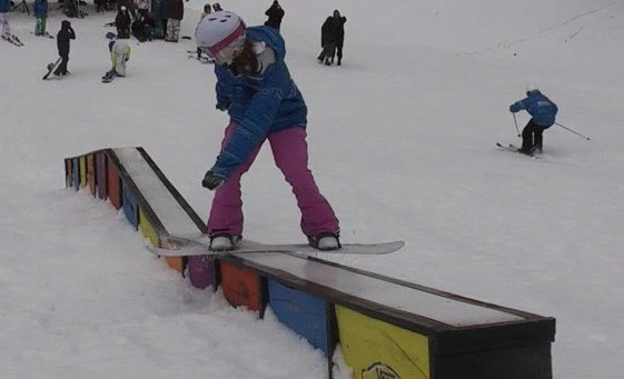 Eleanore Guthrie front-boarding a kink-box at Mt. High, CA circa 2009