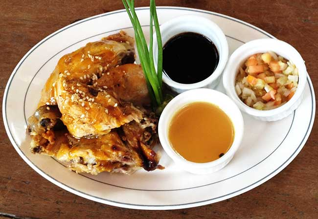 Chicken Inasal Grilled food over hot charcoal is an all-time Filipino comfort food. Inasal  originated  from  the Visayas. The secret is frequent basting of the marinade, consisting of    Visayan Vinegar (langgaw), annatto oil and lemon grass while the chicken is roasting.