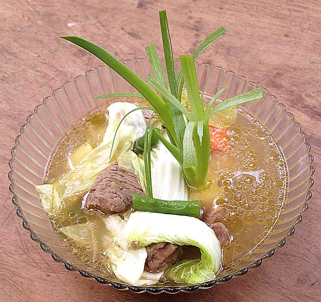Bulalo Originally from Batangas (the center of the cattle industry in Luzon) and a favorite throughout the Philippines, this dish is simmered using knee caps and beef shin, celery, whole peppercorns, cabbage and petchay and becomes a rich, delicious beef broth consumed piping-hot over rice.