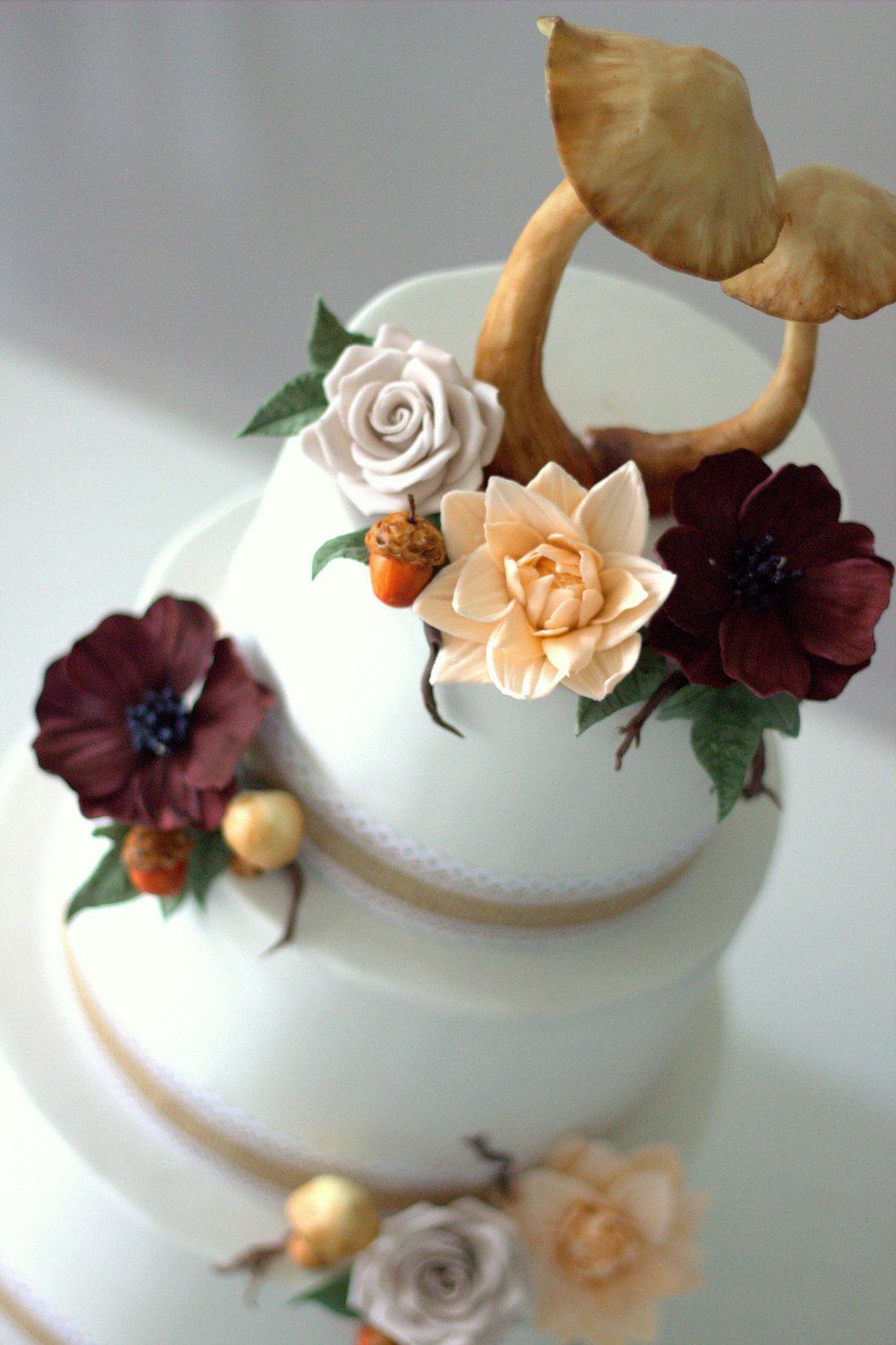 Plum & Ivory three tier wedding cake