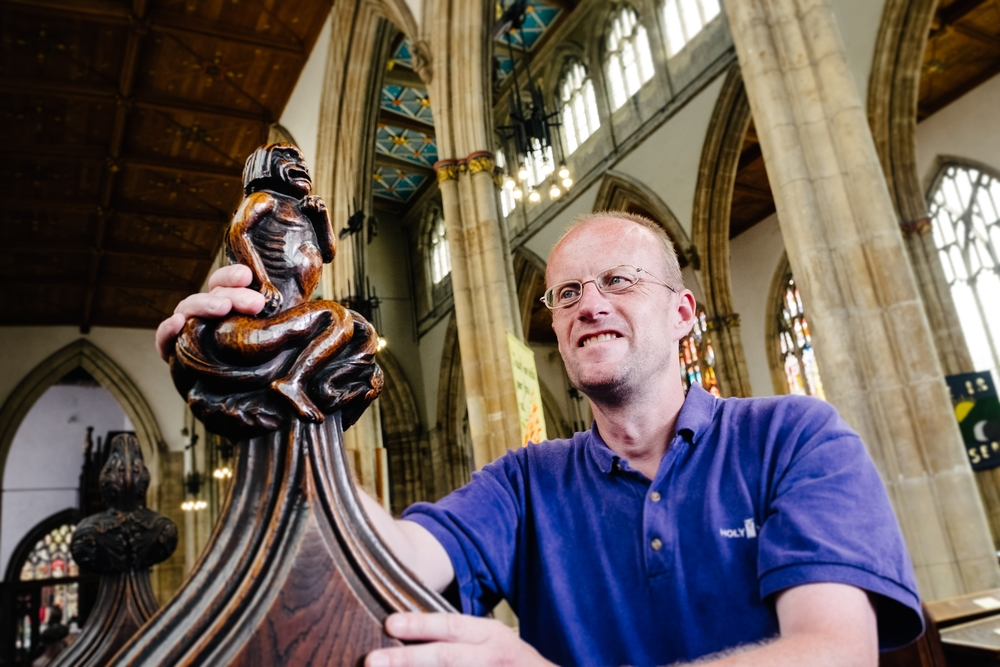 Well-wishers are also being encouraged to sponsor the Holy Trinity pews, which feature elegantly-carved ends, such as this one viewed by volunteer David Ideson.
