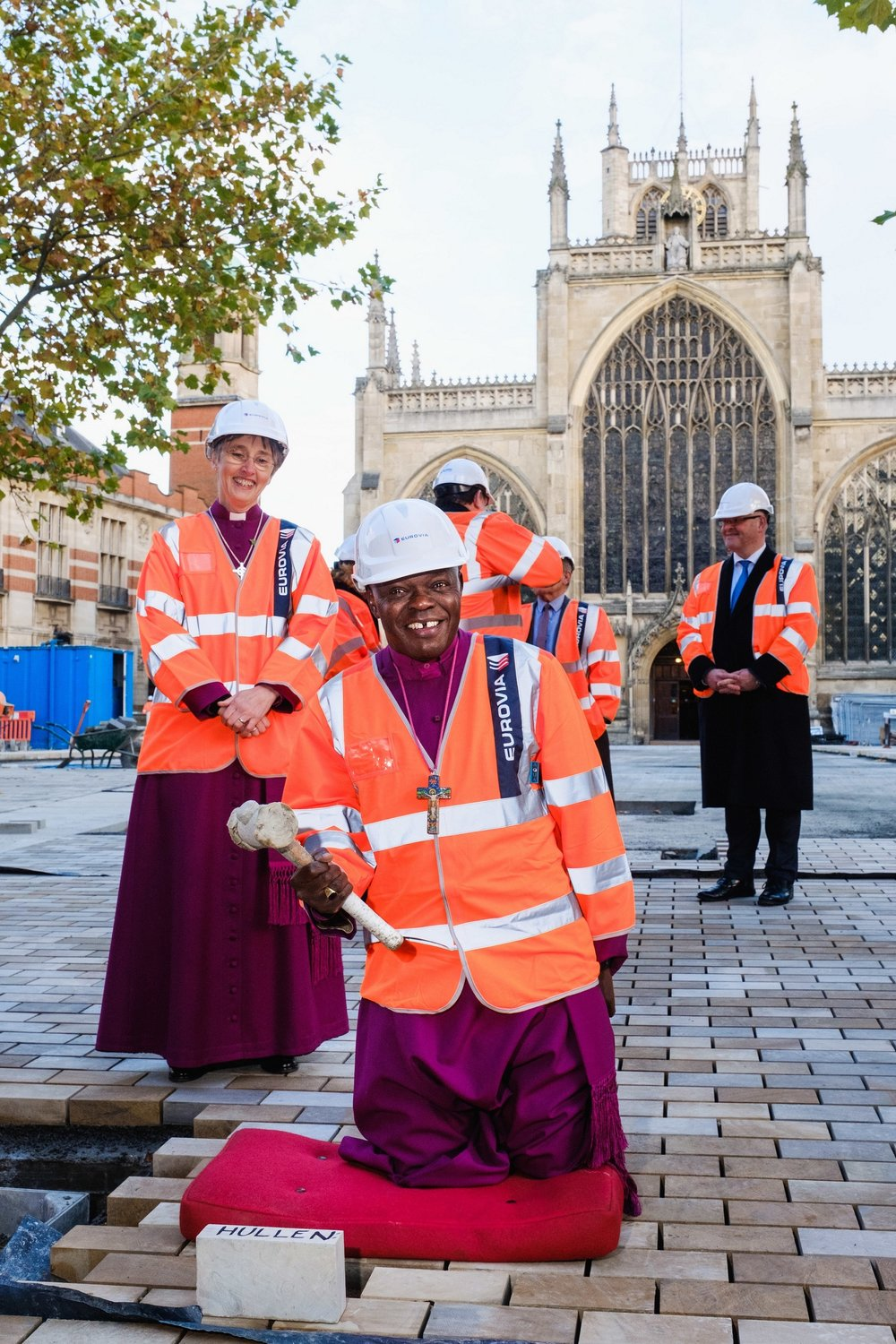 The Archbishop of York wields a mallet as he prepares to hammer in a paving stone as part of the redevelopment of Trinity Square, in the shadow of Hull's historic Holy Trinity Church.