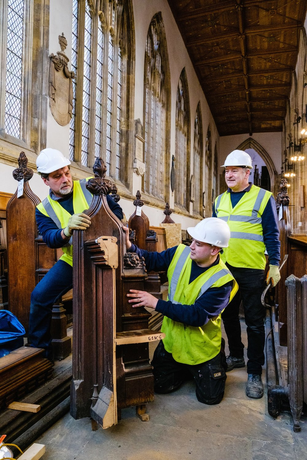 Wood carvers, from left, Ogninian Ivanov, Andy Thompson and Andrew Martindale are dismantling pews at Holy Trinity Church ready for remodelling at the workshops of bespoke architectural joiners Houghtons of York.