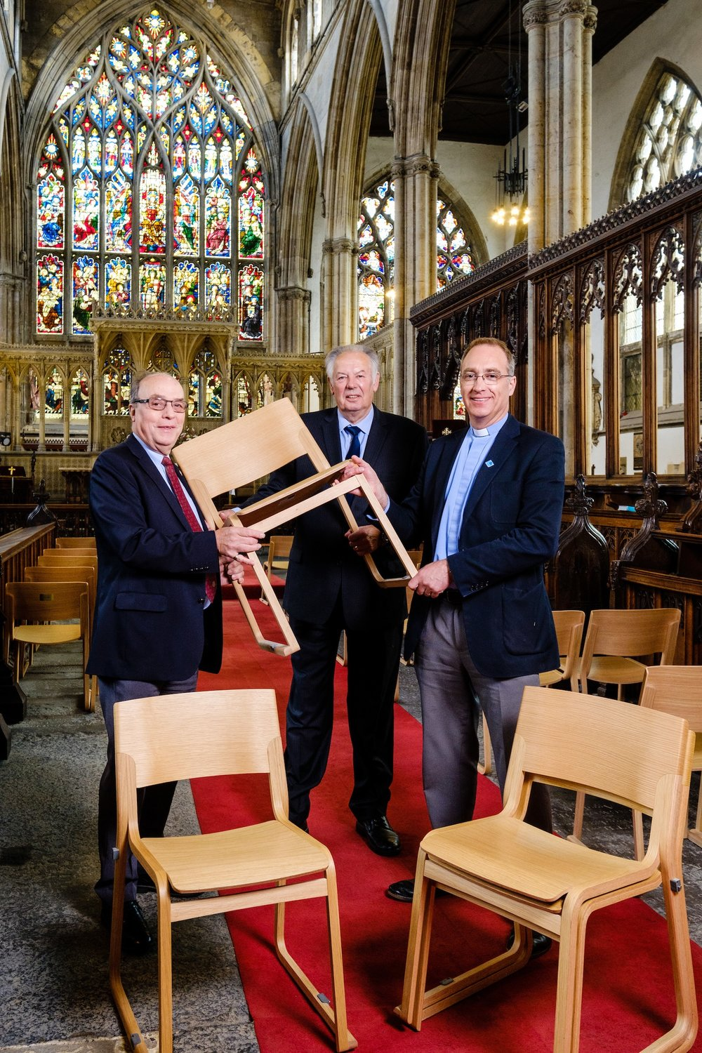 From left, Robin Mason, of the Rotary Club of Hull, Captain Dennis Robinson, of Trinity House, and the Vicar of Hull Minster, Neal Barnes, with the new chairs providing elegant and comfortable seating as part of the transformation of the magnificent church.