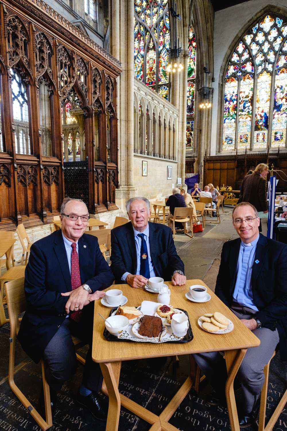ull Minster supporters Robin Mason, left, and Captain Dennis Robinson enjoy afternoon tea with Vicar Neal Barnes in the church's Café Trinity, which has been refurnished with chairs funded by donors.