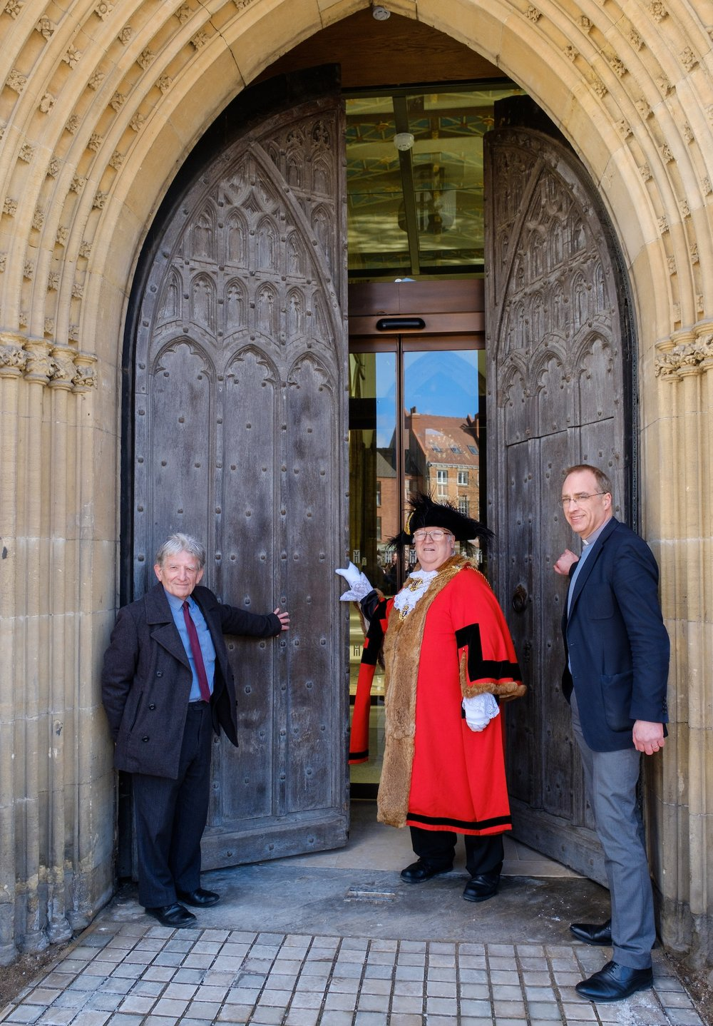 The Lord Mayor of Hull, Councillor John Hewitt, became the first person to enter following the re-opening of Hull Minster's West Doors by city council Leader Steve Brady and Vicar Neal Barnes.
