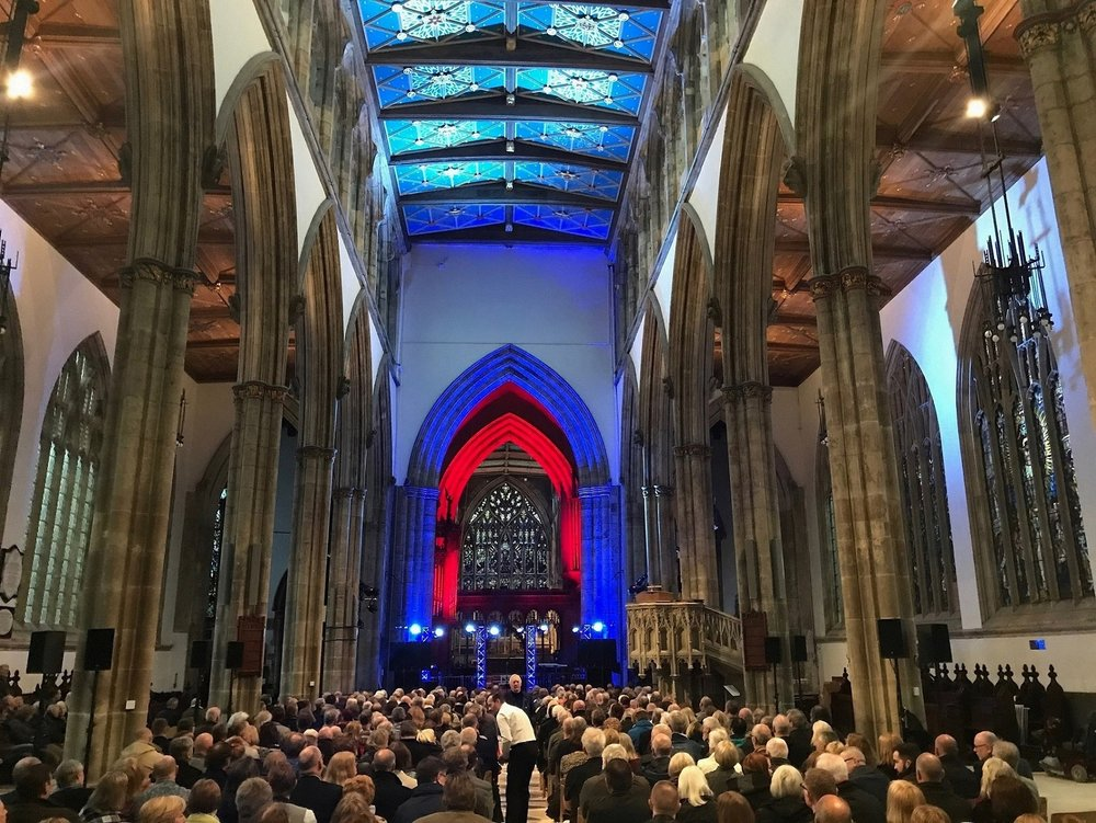 Audience members in the remodelled Nave at Hull Minster. Changes under the Minster's development project have enabled the church to accommodate a wide range of performances and events.