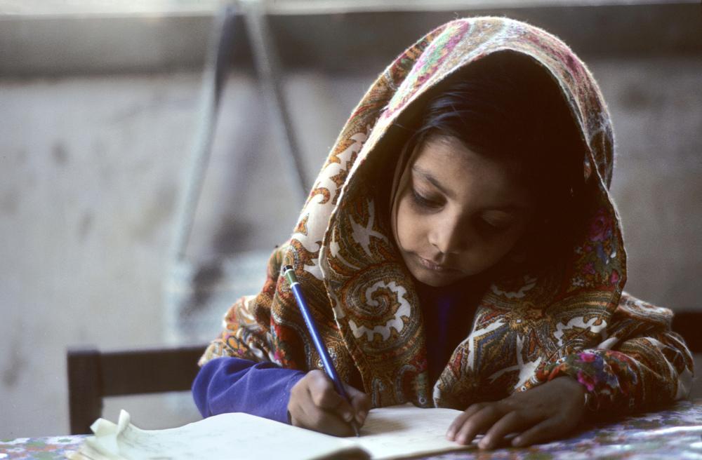 A young girl does her school work in Karachi Pakistan.jpg