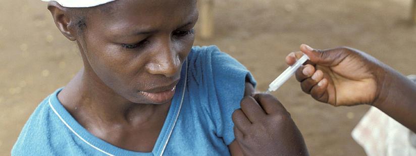 Woman getting vaccinated in Ghana. Photo: Curt Carnemark/World Bank