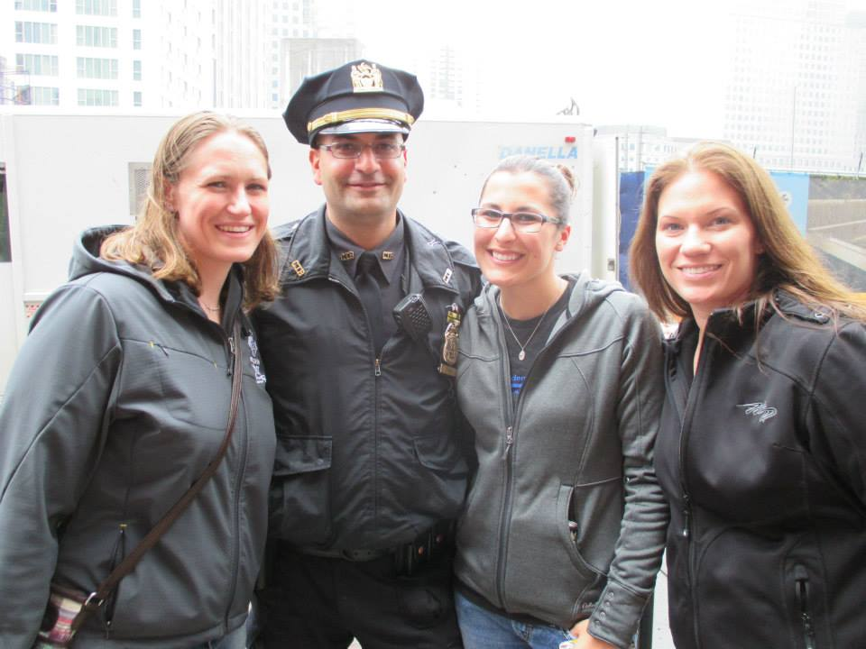 Katie Gierach, Megan Primo and Jen Gerke with Sgt. Frank Chiodi of the NYPD.