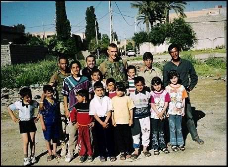 Craig in Mosul, Iraq with the locals, 2003